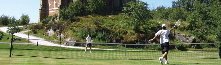Playing tennis on the grass courts